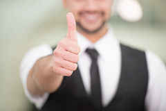 Businessman. Happy young Indian businessman with thumb up Royalty Free Stock Photo