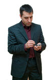Businessman. Young businessman typing with a stylus on a touchscreen mobile phone Stock Photos