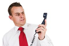 Businessman #43. Business man being shouted at on the phone Royalty Free Stock Photo
