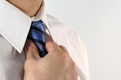 Businessman. Business man tying a tie Stock Photo