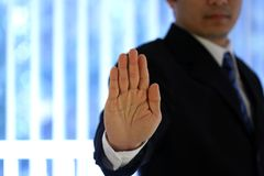 Businessman. With hand raised Stock Images
