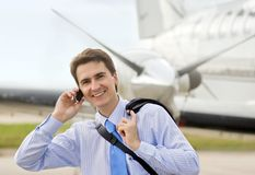 Businessman. On airport with a mobile phone Stock Photos