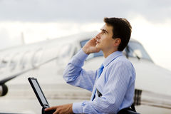 Businessman. Buy tickets on plane through internet Royalty Free Stock Images