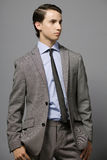 Businessman. Attractive young businessman in gray suit Stock Image