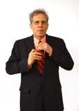 Businessman. Fixing necktie, preparing for interview Stock Photography