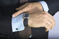Businessman. Watching the time on your watch Stock Image