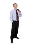 Businessman. Smiling middle aged businessman with jacket over shoulder, isolated on white background Royalty Free Stock Photos