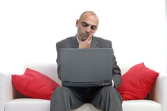 Businessman. With laptop thinking isolated in white Stock Photography