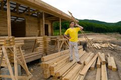 Businessman. Construction of a new camping on coast of a sea bay.The businessman speaks on mobile Stock Images