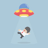 Businessman abducted by Alien spaceship or UFO Royalty Free Stock Photography