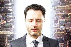 Businessman on abstract city background stock photo