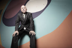 Businessman on abstract colors Stock Photography