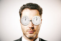 Businessman with abstract glasses clock Stock Images