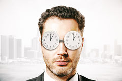 Businessman with abstract glasses clock Royalty Free Stock Image