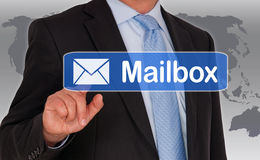 Businessman accessing mailbox Stock Photos