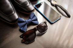 Businessman accessories. Man`s style. Men`s Accessories : Men`s butterfly, Men`s shoes , men`s watches. royalty free stock photography