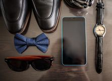 Businessman accessories. Man`s style. Men`s Accessories : Men`s butterfly, Men`s shoes , men`s watches. royalty free stock images