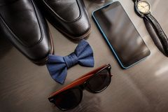 Businessman accessories. Man`s style. Men`s Accessories : Men`s butterfly, Men`s shoes , men`s watches. royalty free stock image