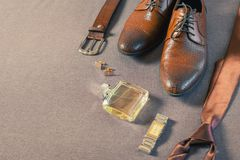 Businessman accessories. Man`s style. Men`s Accessories. A set of clothes for the groom. Wedding shoes, belt, tie, perfume, cufflinks. The whole set of men is Stock Images