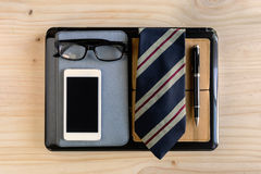 Businessman accessories and notebook bag on desk Stock Photo