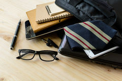 Businessman accessories and notebook bag on desk Stock Photos