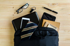 Businessman accessories and notebook bag on desk Royalty Free Stock Photos