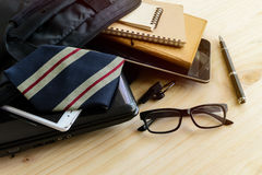 Businessman accessories and notebook bag on desk Royalty Free Stock Photography