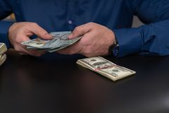 Businessman or accountant counting money stock photo