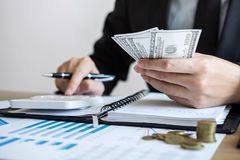 Businessman accountant counting money and making notes at report doing finances and calculate about cost of investment and. Analyzing financial data, Financing stock images