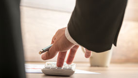 Businessman or accountant doing important financial calculation Royalty Free Stock Image