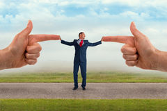 Businessman accusation concept. Fingers pointing Stock Images