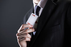 Businessman with ace card Stock Images