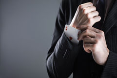 Businessman with ace card. Hidden under sleeve Royalty Free Stock Images