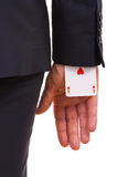 Businessman with ace card hidden under sleeve. Business man with ace card hidden under sleeve Royalty Free Stock Photography