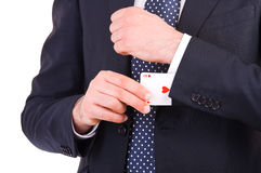 Businessman with ace card hidden under sleeve. Stock Photography