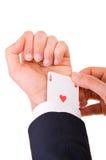 Businessman with ace card hidden under sleeve. Business man with ace card hidden under sleeve Stock Photo
