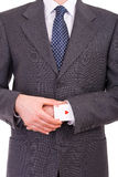 Businessman with ace card hidden under sleeve. Business man with ace card hidden under sleeve Stock Photography