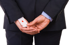 Businessman with ace card hidden under sleeve. Stock Photo