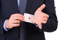 Businessman with ace card hidden under sleeve. Royalty Free Stock Photography