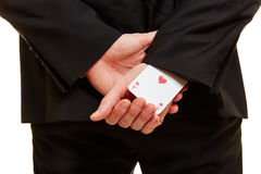 Businessman with an ace under his sleeve. Businessman taken from the back with an ace under his sleeve Stock Images