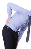 Businessman with aching back. Business man with aching back stock photography