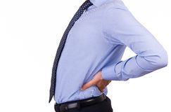 Businessman with aching back. Business man with aching back Royalty Free Stock Images