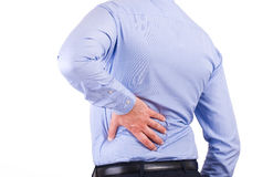 Businessman with aching back. Business man with aching back stock images