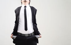 Businessman acting display that symbol of bankrupt Royalty Free Stock Photography