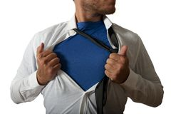 Businessman acting like a super hero stock image