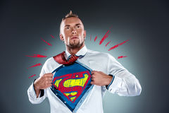Businessman acting like a super hero and tearing royalty free stock images