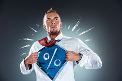Businessman acting like a super hero and tearing Royalty Free Stock Photo