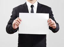 Businessman acting show paper for something communicate Royalty Free Stock Images