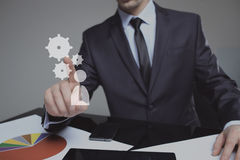 Businessman Activate Gears, Touch Screen Concept. Businessman Activate Gears, Touch Screen, technology and internet Concept stock photos