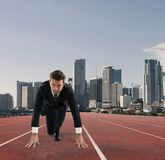 Businessman acts like a runner. Competition and challenge in business concept. Businessman acts like a runner on a track. Competition and challenge in business Royalty Free Stock Images